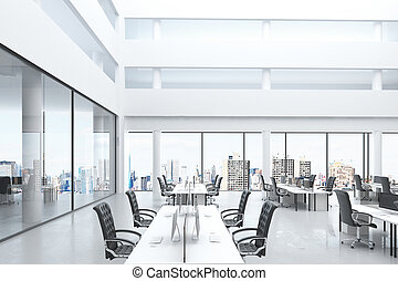 Modern open space office with big windows and furniture