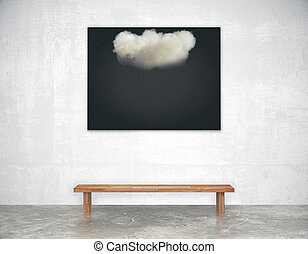 Black picture with white cloud with wooden bench in empty loft room