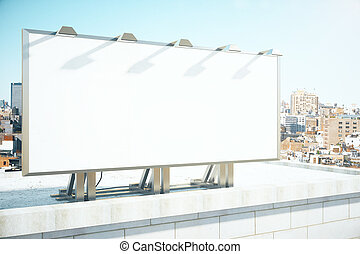 Blank billboard on the roof of building at megapolis city...