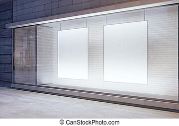 Blank white posters in the window on night empty city...