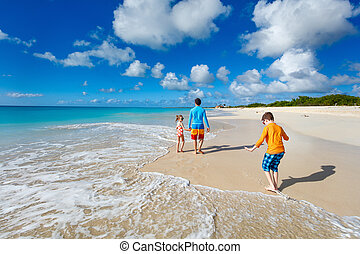 Father with kids at beach - Father and kids enjoying...
