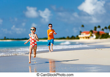 Kids having fun at beach - Kids having fun at tropical beach...