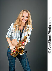 sincere laugh - young caucasian blond saxophone player with...