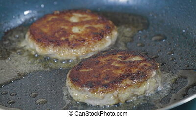Cutlets frying in pan - Frying pan cutlets are fried.