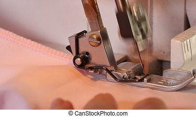 Seamstress Sews Clothes Over Lock - Over locking the mesh...