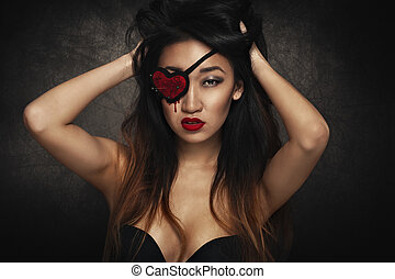 Woman with eye patch - Beautiful woman with heart shape eye...