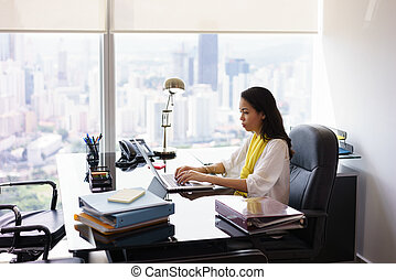 Business Woman Secretary Typing On Laptop Computer In Office