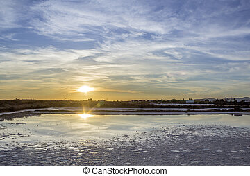 Sunset landscape view of Ria Formosa wetlands natural...