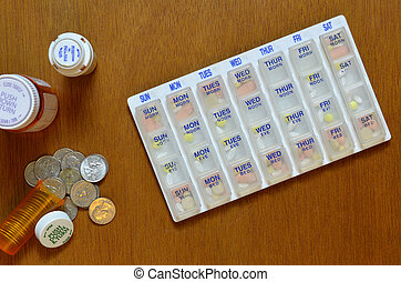 Pillbox, medicine bottle with money - Pillbox and medicine...