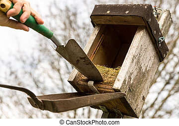 birdhouse with old nest - opened birdhouse with old nest in...