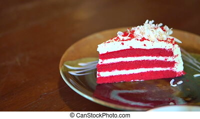 red velvet cake serving on plate - video of red velvet cake...