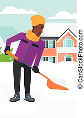 Man shoveling and removing snow - An african-american man...