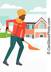 Woman shoveling and removing snow. - An african-american...