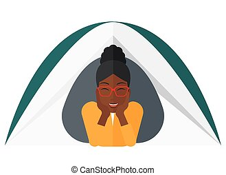 Woman lying in tent - An african-american woman crawling out...