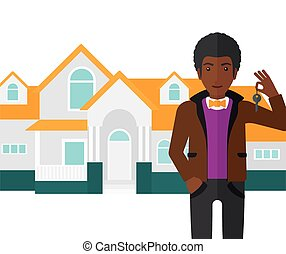 Real estate agent with key - An african-american real estate...