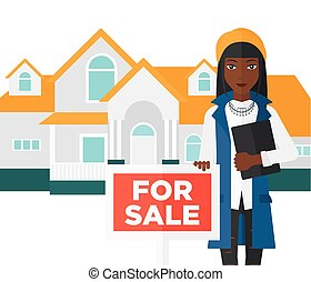 Real estate agent offering house - An african-american woman...