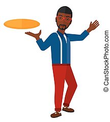 Man playing frisbee. - An african-american man playing...