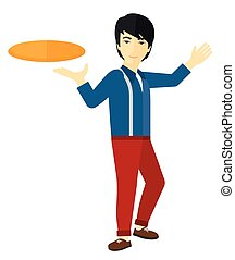 Man playing frisbee. - An asian man playing frisbee vector...