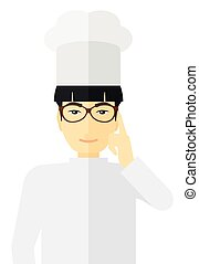Chef pointing forefinger up. - An asian chief-cooker in...
