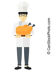 Man holding roasted chicken - An asian chef holding a plate...