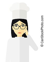 Chef pointing forefinger up - An asian chief-cooker in...