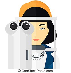 Patient visiting ophthalmologist - An asian female patient...