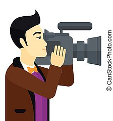 Cameraman with video camera - An asian cameraman with video...