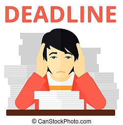 Man having problem with deadline - An asian man holding his...