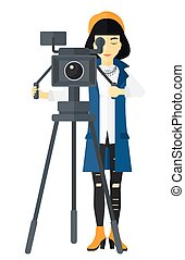 Camerawoman with movie camera - An asian camerawoman looking...