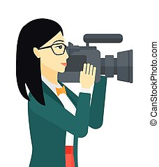 Cameraman with video camera. - An asian cameraman with video...