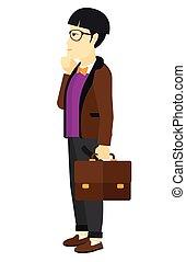 Man looking at departure board. - An asian man looking at...