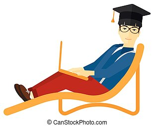 Graduate lying on chaise lounge with laptop - An asian man...