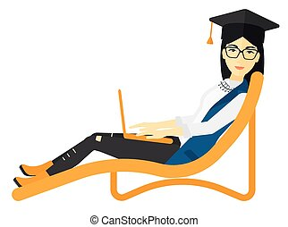 Graduate lying in chaise lounge with laptop - An asian woman...