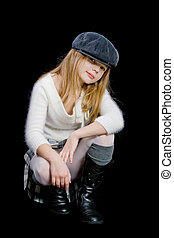 teen in cap - young teen blond girl sitting in gray cap...