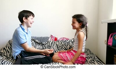 boy and girl playing a game of rock paper scissors - boy and...