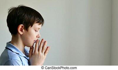 boy teen praying belief in god - boy teen praying belief in...