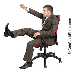 Businessman sitting on chair and kicking space isolated on...