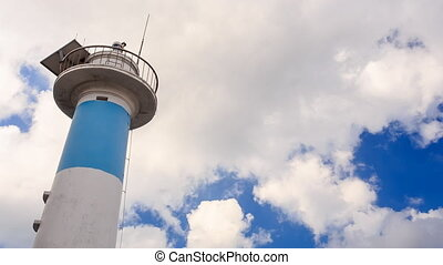 Lighthouse Top Part against Clouds Motion in Blue Sky - top...