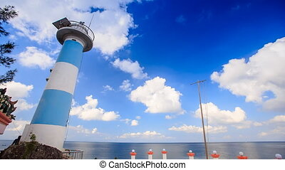 Bent Lighthouse against Sea Clouds Motion in Blue Sky - bent...