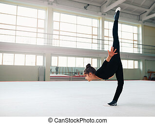gymnast performs a balance with split - The gymnast performs...