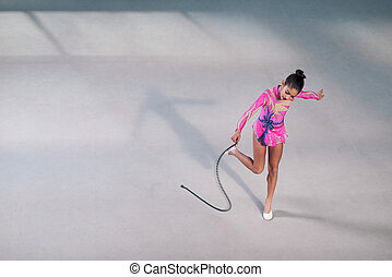 gymnast in a beautiful dress dancing with rope - gymnast in...