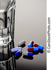Capsules with a Glass of Water - Capsules with a glass of...