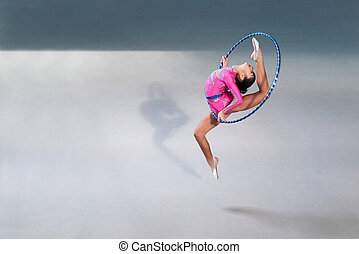gymnast beautiful dress with a hoop in jump - gymnast in a...