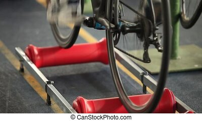 man to twist pedal - Roller bike for the warm up before the...