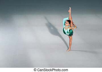 gymnast performs balance and splits - gymnast performs in a...
