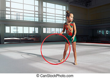 Girl gymnast with hoop looking away - Girl gymnast with a...