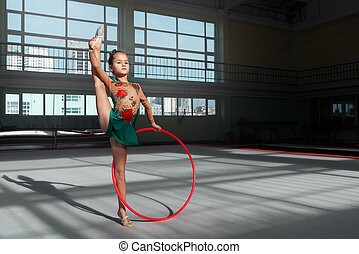 gymnast in suit performs exercises with a hoop - gymnast in...