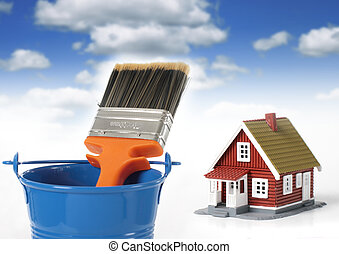 Brush and bucket. House on the background.