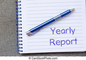 Yearly report write on notebook - Yearly report text concept...