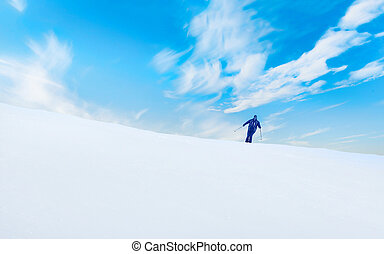 Young man skiing on the mountain